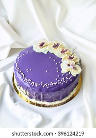 Amazing violet cake decorated with white chocolate orchids