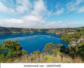 Amazing Volcano Crater Blue Lake with stunning reflection of the Crater Rim and historic pumping station for town water supply.  Blue colour between November and March. Mount Gambier,  South Australia