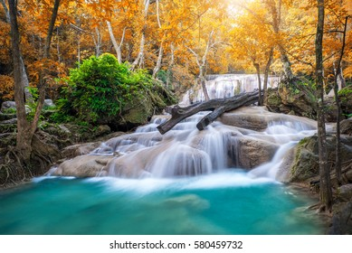 Amazing waterfall in wonderful autumn forest