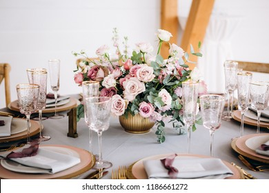 Amazing wedding table decoration with flowers on wooden tables