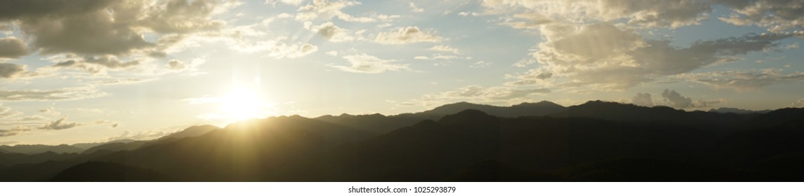Amazing wild nature view of layer of mountain forest landscape with cloudy sky when sunset or twilight. Natural green scenery of cloud and mountain slopes background. Maehongson,Thailand