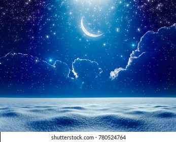 Amazing winter background - crescent moon in dark blue night starry sky above snowy field, cold winter weather, bright blue spotlight from skies. Elements of this image furnished by NASA