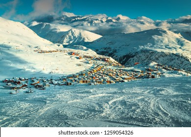 Amazing winter landscape, famous ski resort with snowy buildings and snowy houses in French Alps, Alpe D Huez, France, Europe