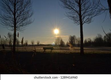 amazing winter park frozen landscape view with trees green meadow field trees blue sky sun