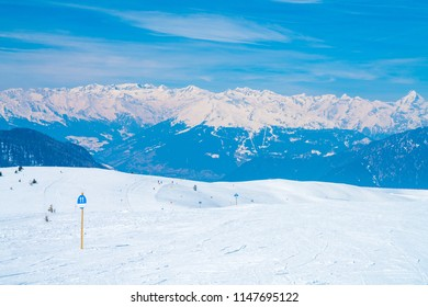Amazing winter ski resort mountain view with skiing slopes and mighty mountains.