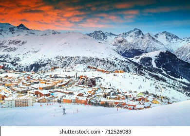 Amazing winter sunrise landscape and famous ski resort in French Alps, Alpe D Huez, France, Europe
