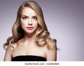 Amazing Woman Blond. Beautiful Girl studio face portrait. Studio shot.
