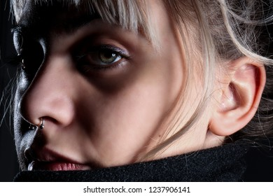 Amazing young beautiful woman with wonderful blue eyes posing for studio shuts