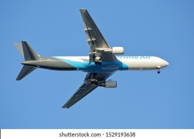 An Amazon Air, formerly Prime Air, cargo jet on approach to Kelley Field Annex.  Amazon.com Inc is a NASDAQ publicly traded retail company with ticker AMZN - San Antonio, Texas, USA - October 10, 2019