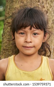 Amazon Child Portrait - Indigenous People Living in a Traditional Wooden Houses Settlement in the region of Rio Negro, Amazon Rainforest. Iquitos, Amazon, Peru, Oct, 2019