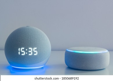 Amazon echo dot 4, Alexa voice controlled speaker with activated voice recognition, on light background.