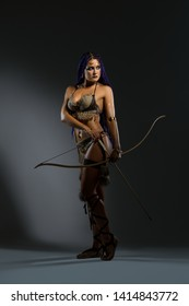Amazon in lingerie holding bow and arrows