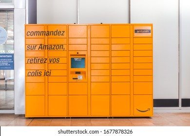 Amazon Locker in shopping mall, orange pick up point for mail order goods with Amazon brand logo on it. Lyon, France - February 23, 2020