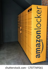 Amazon locker in shopping mall, orange pick up point for mail order goods with Amazon brand logo on it. Sabadell, Spain - April 9, 2020