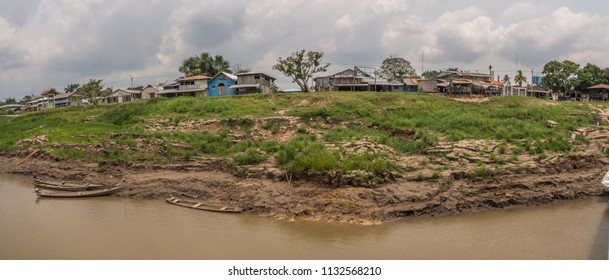 Amazon River, Brazil - March 10, 2018: Small village on the bank of Javari River, the tributary of the Amazon River, Amazonia.Selva on the border of Brazil and Peru. South America.