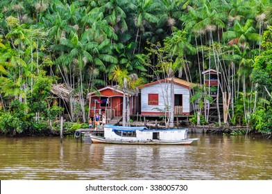 AMAZON RIVER, BRAZIL - MAY 11, 2012: Flooded local huts as seen from the boat on the Amazon River in Brazil.