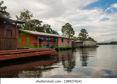 Amazon river, Manaus, Amazonas, Brazil: Beautiful landscape overlooking the Amazon river with houses.