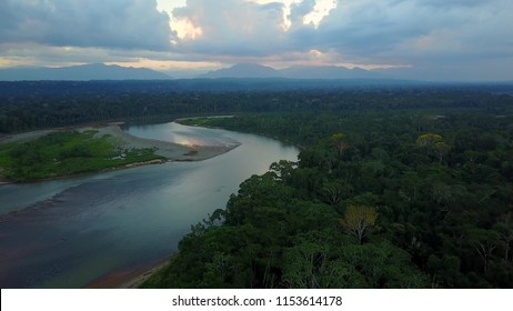 Amazon River in the middle of a lush forest at sunset