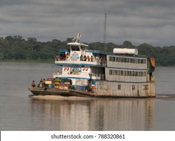 Amazon River, Peru - Dec 12, 2017: Cargo boat in the middle of Amazon river