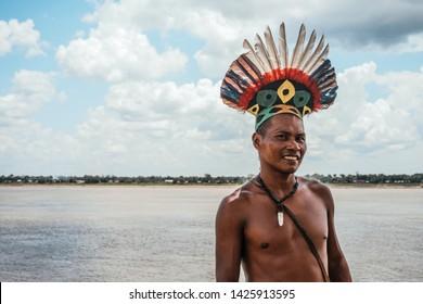 Amazon River/Colombia - October 16 2019:  Tikuna man in front of amazon river