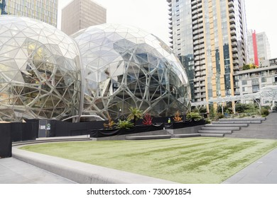 the Amazon world headquarters campus lawn and office towers featuring the Spheres terrariums located in downtown Seattle taken late afternoon under overcast sky circa October 2017.