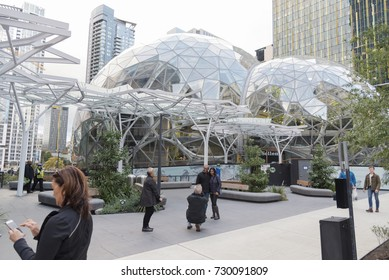 the Amazon world headquarters campus and office towers featuring the Spheres terrariums with people located in downtown Seattle taken late afternoon under overcast sky circa October 2017.