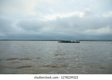 amazonas river, boat in the jungle river perú
