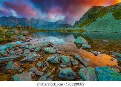Amazong sunset reflection in a mountain glacier lake