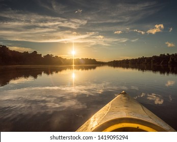 Amazonia. Sunset view seen from the kayak. Coati Lagoon near the Javari River, the tributary of the Amazon River. Selva on the border of Brazil and Peru. South America.
