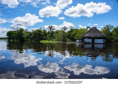 Amazonian house on the river in a beautiful day.