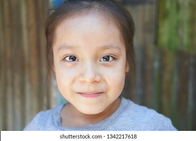 Amazonian Native Beautiful Little Girl Smiling Portrait in Iquitos Tribes, Amazon Rainforest - Peruvian, Brazilian and Colombian Border. Iquitos, Amazon, Peru, March, 2019