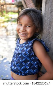 Amazonian Native Little Girl Smiling Portrait in Iquitos Tribes of Rio Negro Region, Amazon Rainforest - Peruvian, Brazilian and Colombian Borders. Iquitos, Amazon, Peru, March, 2019