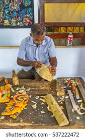 AMBALANGODA, SRI LANKA - DECEMBER 5, 2016: The artisan in process of mask making in the workshop of the Mask Museum, on December 5 in Ambalangoda.