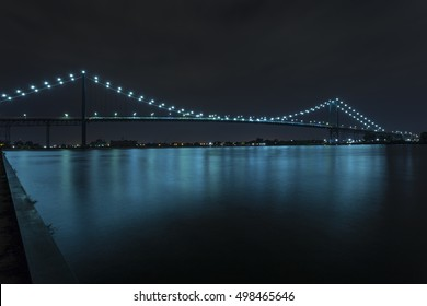 Ambassador Bridge connecting Windsor, Ontario to Detroit Michigan at night.