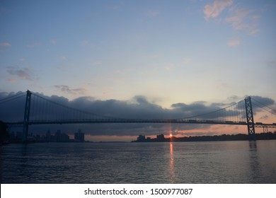 Ambassador Bridge Detroit Michigan Skyline Sunrise over Detroit River Windsor Ontario.