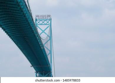 Ambassador Bridge - vehicle suspension bridge across Detroit River, connecting Windsor, Ontario, Canada and Detroit, Michigan, USA. Space for copy.