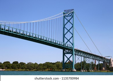 The Ambassador Bridge which spans the Detroit River which connects Detroit, Michigan, USA to Windsor, Ontario, Canada. Built in the early 1930's