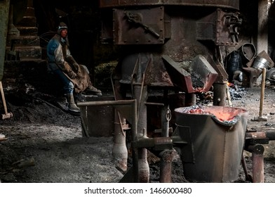 Ambato, Ecuador. 2015. Metallurgical plant worker takes a break while the oven reaches its temperature point.