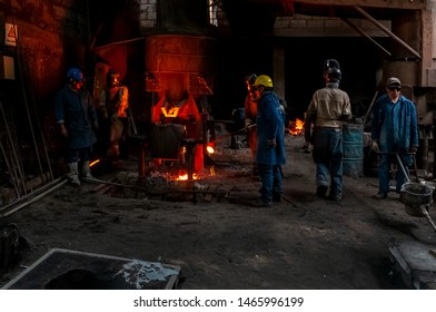 Ambato, Ecuador. 2015. Workers who control the melting of metal in furnaces. Workers operate at the metallurgical plant. Where the liquid metal is poured into molds.
