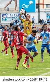 Ambato, Ecuador - April 13. 2019: Match by Liga Pro - Banco Pichincha between the Macará and Mushuc Runa. Attack of the Macará that the Mushuc Runa keeper manages to control.