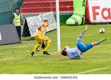 Ambato, Ecuador - April 13. 2019: Match by Liga Pro - Banco Pichincha between the Macará and Mushuc Runa. The Argentine attacker Flavio Ciampichetti falls within the area product of his intense search