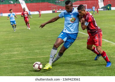 Ambato, Ecuador - April 13. 2019: Match by Liga Pro - Banco Pichincha between the Macará and Mushuc Runa. Michael Estrada scorer of the Macará inside the enemy area looking for the score.