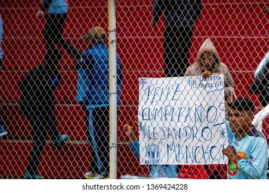 Ambato, Ecuador - April 13. 2019: Match by Liga Pro - Banco Pichincha between the Macará and Mushuc Runa. A fan of Macará shows his love to the player Manchot for being the day of his birthday.