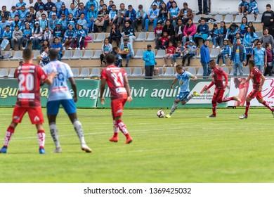Ambato, Ecuador - April 13. 2019: Match by Liga Pro - Banco Pichincha between the Macará and Mushuc Runa. Attack by Carlos Feraud captain of Macará, the defensive attitude of his rivals is appreciated
