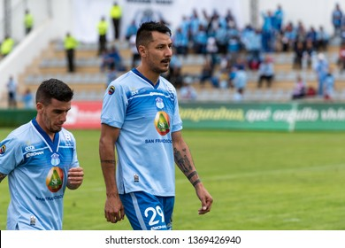 Ambato, Ecuador - April 13. 2019: Match by Liga Pro - Banco Pichincha between the Macará and Mushuc Runa. The players Manchot & Rizotto go to the dressing room, sad at the loss 0-1 in the first half.