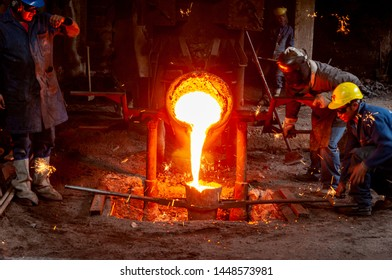 Ambato, Ecuador - July 11. 2019: Smelting of steel in an artisanal steel mill in the city of Ambato, we can see the moment in which the material is red hot.