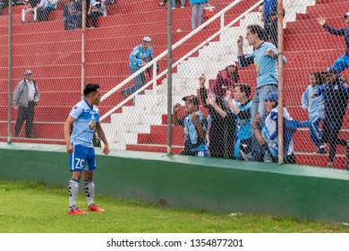 Ambato, Ecuador - March 30. 2019: Match by Liga Pro - Banco Pichincha in the city of Ambato between the Macará and U. Católica teams. Celebration of Roland Champang's goal with the fans