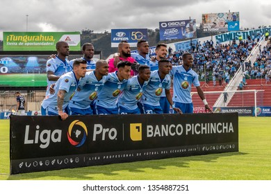 Ambato, Ecuador - March 30. 2019: Match by Liga Pro - Banco Pichincha in the city of Ambato between the Macará and U. Católica teams. Macará team posing for the media at the start of the game.
