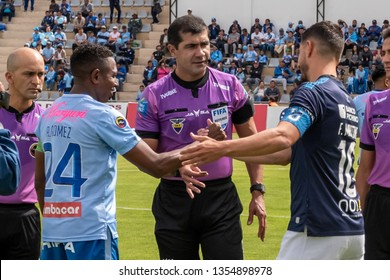 Ambato, Ecuador - March 30. 2019: Match by Liga Pro - Banco Pichincha in the city of Ambato between the Macará and U. Católica teams. Greetings between captains and referees at the start of the game.