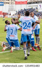 Ambato, Ecuador - March 30. 2019: Match by Liga Pro - Banco Pichincha in the city of Ambato between the Macará and U. Católica teams. Celebration of Roland Champang's goal among the players.